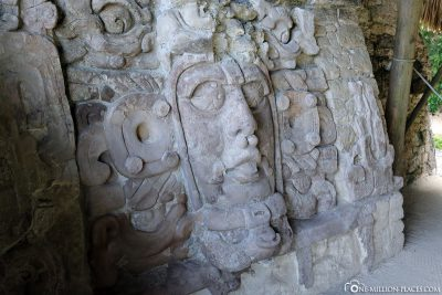 The masks carved in stone