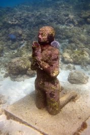 A praying figure