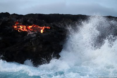 Glowing lava in the surf