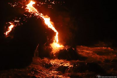 A small lava flow reaches the ocean