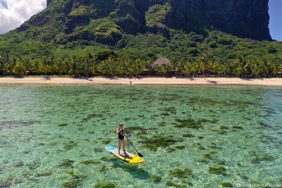 Stand Up Paddling in crystal clear water