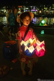 Sale of paper boats with candles