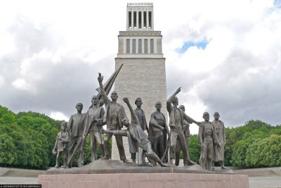 Bell tower and group of figures